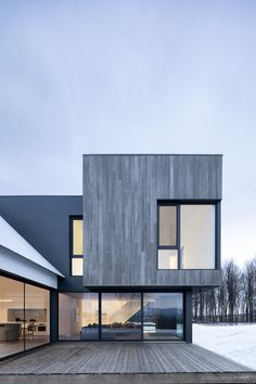 The Minimalist Knowlton Residence in Quebec by TBA - Design Milk - - Knowlton Residence is a minimalist house in Quebec, Canada, by TBA designed as a renovation and extension of an aging country farmhouse. Minimalist House Design, Minimalist Architecture, Facade Architecture, Minimalist Home, Modern House Design, Minimalist Interior, Minimalist Bedroom, Bedroom Modern, Architecture Portfolio