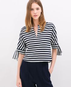 Shop the affordable Blue White Striped V-neck Half Sleeve Blouse from Tops collection that inspired by most covetable trends. Save your budget by purchasing your Blue White Striped V-neck Half Sleeve Blouse here! Blouse Styles, Blouse Designs, Blouse Sexy, Bow Blouse, Half Sleeve Shirts, Mode Plus, Trendy Fashion, Fashion Outfits, Dress Fashion