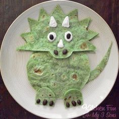Dinodilla tortillas. Or maybe a quesadilla, or other variation of this recipe for the dinosaur party... (from original source)