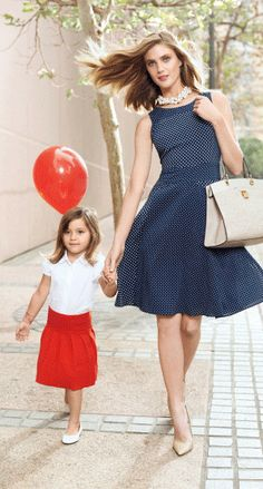 Mom and daughter are not wearing the same colors here, but they look so great together! Try wearing blue and nude tones, and put your little girl in something red and white for an overall nautical vibe that's classic and fresh.