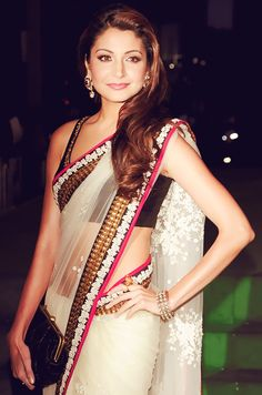 Anushka Sharma at IIFA 2011 in a white self-work net saree with black blouse and black, pink and gold border by SabyaSachi.