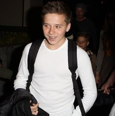Brooklyn Beckham <3 isn't he just too cute! Although I'm still in favour of his dad!! Awk... After all my name is tattooed onto his chest!! <3 lol.