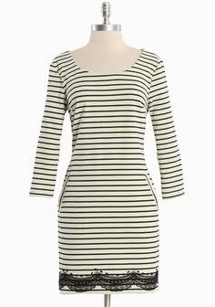 """Saturday Tunic Dress By Nick & Mo 66.99 at shopruche.com. We adore the unique details of this black and white striped dress in a cotton blend by Nick & Mo. Finished with black lace details, front pockets, and a hint of stretch for a flattering silhouette. Back zipper closure.  85% Polyester, 10% Cotton, 5% Spandex, Imported, 32.5"""" length from top of shoulders, 31"""" waist measured from a small"""