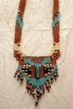 """Beginner"" - 1995 - My first project: adjustable length beads woven in, glitter thread accent, stairstep design, PERSONAL COLLECTION. Woven by Terri Scache Harris, theravenscache.shutterfly.com   Hand woven, handwoven, weaving, weave, needleweaving, pin weaving, woven necklace, fashion necklace, wearable art, fashion necklace, fiber art."