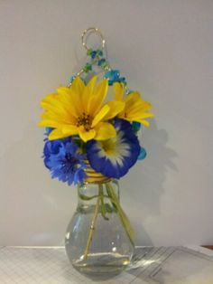 Light bulb jar that I added beads to and some mini sunflowers & wild flowers from my garden.