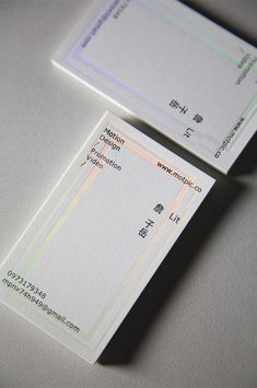 Minimal business card in white. with clear holographic deboss