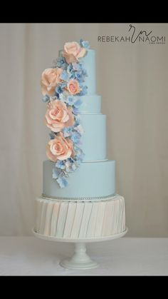 """Pantone colors of the year inspire this elegant spring wedding cake. A romantic combination of roses and hydrangea in soft serenity blue and rose quartz "" Rebekah Naomi Cake Design"