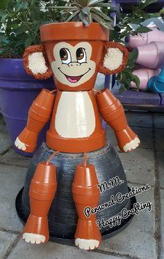Cute finished terra cotta pot monkey