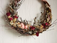 """Rose Wreath, Dried Flower Wreath, Bird Nest with Eggs, Pussy Willow Decor, OOAK Decor  For this wreath I've twined a little bird nest out of twigs from my birch trees, & composed it in a gathering of branches, twigs, flowers & grasses from my gardens & fields, then adorned it with a ribbon of vintage calico fabric & little faux bird's eggs. The dried roses in the composition are still very fragrant.  Measures approx. 20"""" outside width x 4.5"""" deep; base is approx. 13"""" diameter. My wreaths are…"""