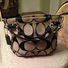 Host pick 9/19/14Authentic Coach Brooke bag ❗️Reduced from $140❗️Beautiful authentic Coach bag, small wear on the bottom corners shown in pics, recently stitched the corners so wear won't show, very small makeup stains inside should be easy to remove. Posting new pics soon Coach Bags