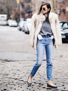 Danielle Bernstein of We Wore What in a short fur jacket and skinny jeans