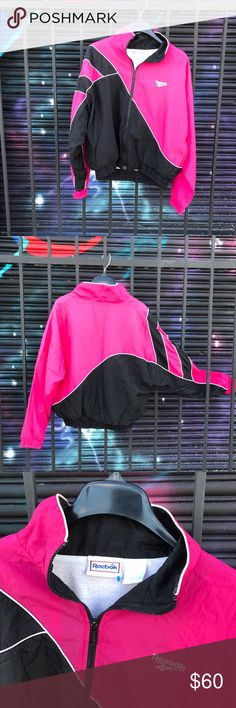 Women's vintage Reebok windbreaker *RARE* Pink & black retro women's vintage windbreaker. SUPER RARE PIECE  Looks great on. Has no imperfections, wear, tears, holes, stains, fading. It's in near perfect condition. Any questions please feel free to ask. Will fit a woman's XS-M or a petite Large Reebok Jackets & Coats