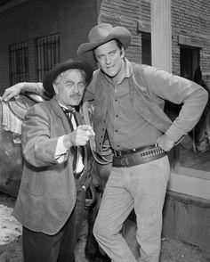 Milburn Stone as Dr. Galen 'Doc' Adams and James Arness as Marshal Matt Dillon. Milburn Stone, Old Western Movies, Gary Clark, Matt Dillon, Miss Kitty, Tv Westerns, Best Western, Old Tv, Hollywood Actor