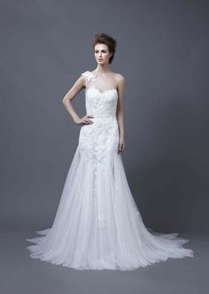 Love this one shoulder illusion neckline from Enzoani's 2013 #wedding dress collection.