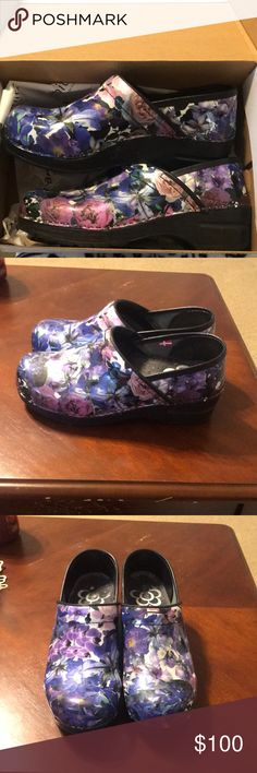 Nursing Sanita shoes These shoes are great for people who are working in health care or on their feet all day. These blue, white and purple flowered beautiful Sanita clogs are a size 38 which is equivalent to a size 8. Sanita Shoes Mules & Clogs