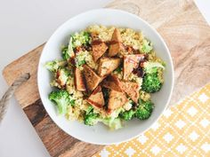 Recipe for a vegan BBQ Couscous Bowl with curried couscous, broccoli, crispy tofu and BBQ sauce. It's the perfect protein-rich lunch.