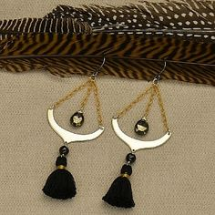 Flirty and free-flowing earrings, perfect for a night out! Easily dress up and look with these statement earrings. Gorgeous faceted pyrite beads, and cute mini cotton tassels freely swing to give this pair movement, and some sparkle. http://www.ninadesigns.com/jewelry_design_ideas/pyrite_pendulums.html
