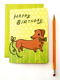 "This happy dachshund card almost makes up for a late birthday greeting! Front: ""HAPPY BIRTHDAY!"" with illustration of a dachshund with a ribbon on his tail Interior: ""Sorry I'm a little behind!"" (With"
