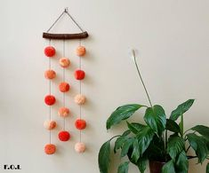 Amazing pompon wall hanging with handmade acrylic pompons hanging by a cotton cord. Length 26.38 (67 cm). Width of wooden stick (oak) 8.27 (21 cm). Diameter of pompons 1.97 (5cm).