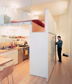 """""""Wonbo had to be able to stand in the sleeping area,"""" architect Kyu Sung Woo says of his son. """"By combining two dimensions—the height of the bed and that of the closet (the top of which forms the bedroom floor)—we made that possible.""""  Photo by Adam Friedberg."""