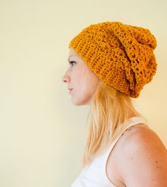 Love the stitch pattern and color! Slouchy hat beanie crocheted - mustard yellow goldenrod - wool. $22.95, via Etsy.