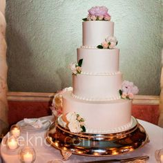 Fresh peonies and roses topped the tiers of this simple fondant cake.