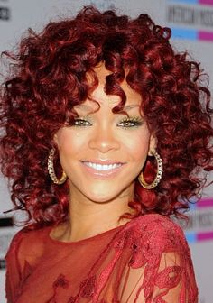 Rihanna, oh you look so georgous with the red hair and the big curls!