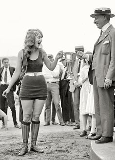Washington Tidal Basin beauty contest winner accepting her prize, August 5, 1922. This was the paradigm of female beauty in those days. Today, she'd never even be accepted as a contestant.