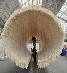 Installation by Chinese abstract artist Zhu Jinshi, constructed from 8,000 sheets of rice paper, 800 bamboo shafts, suspended by cotton thread.  Metaphor of artist's journey from east to west, also honoring the passage from life to afterlife.