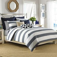 Transform your bedroom into a soothing sanctuary with the Nautica® Lawndale Duvet Cover Set. Adorned with a beautiful navy yarn dyed striped design on a pristine white background, the simplistic bedding is a calming addition to any room.