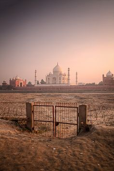 an entirely unprepossessing gate leading to the magnificent Taj Mahal, arguably one of the most beautiful buildings in the world, inarguable the most beautiful mausoleum. Even the simplest threshold can lead to unexpected beauty.