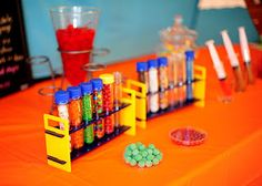 Mad Scientist party using Steve Spangler baby soda bottle test tubes and rack to hold candy. Great idea!