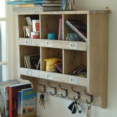 Wall Unit with HooksKeep your hallway or utility clutter free and organised with our wooden Shelf Unit that is perfect for fixing onto the wall. Complete with 6 hooks ideal for hanging coats, scarves, hats and gloves or even a place to store all your keys.•6 cubby holes•6 hanging hooks •Eye hooks for hanging on the wall•H50 x W70 x D20cm£100.00