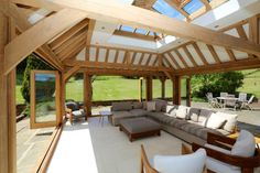 Prime Oak Stunning Tiled Orangery with 3 sets of Bi-folding doors, in the style of indoor-outdoor living