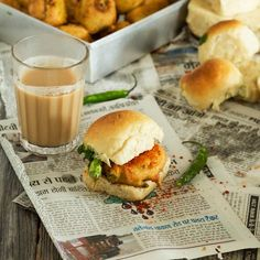 A popular Indian street food - potato fritters tucked in a pav bun with spicy green and garlic chutneys. Perfect with a cup of masala chai!