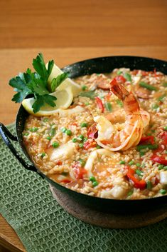 Seafood Paella: saffron-infused rice simmered with a combination of shrimp, scallops and squid