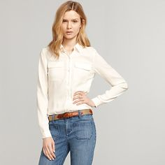 Tommy Hilfiger women's shirt. Our blouse has the curve-skimming drape of silk without any of the fuss, with military details for a modern finish. • Classic fit.• 100% synthetic.• Single-button cuffs, epaulettes.• Machine washable.• Imported.