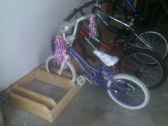 Simple kid's bike storage solution... oh @Marianne Rea I found a project for papa!