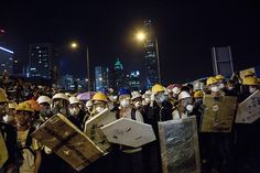 Umbrella Revolution Hong Kong, Pro-democracy protesters prepare to clash with riot police outside Central Government Complex on November 30, 2014 in Hong Kong. According to reports, hundreds of pro-democracy protestors and police faced-off with at least fice potestors arested. (Photo by Lam Yik Fei/Getty Images)