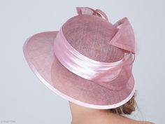 Elisabeth is a graceful formal hat with a romantic arrangement highlighted by a stylish rose and delicate feathers. This headpiece is hand formed and sewed, making it an exclusive design. This artisan cocktail hat would perfectly compliment elegant outfit at a wedding or similar event.