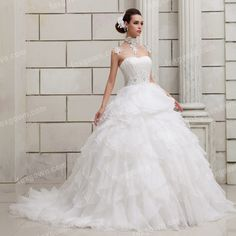 white strapless beaded ruched organza corset bodice wedding gown