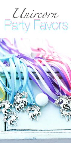 Unicorn Necklace Party Favors. #ad These would be the perfect touch to add to your unicorn party! Love these instead of cheap toys. #birthday #partyideas #partyfavors #unicorn #necklace #ribbon #charms