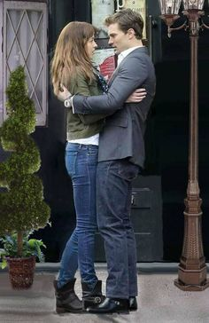 Jamie Dornan with Dakota Johnson in Fifty Shades of Grey