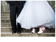 she never wore fancy shoes.  so on her wedding day, she bought matching tennies instead! Amy B Photography 2011