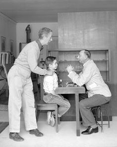 """Reference photo for Norman Rockwell's """"The Optician."""" Licensed by Norman Rockwell Licensing, Niles, IL. From the permanent collection of Norman Rockwell Museum."""