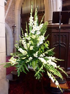Ceremony flowers white lillies and white Gladiolus, simple greenery White Floral Arrangements, Creative Flower Arrangements, Church Flower Arrangements, Church Flowers, Beautiful Flower Arrangements, Beautiful Flowers, Church Pew Wedding Decorations, White Corsage, Gladiolus Flower