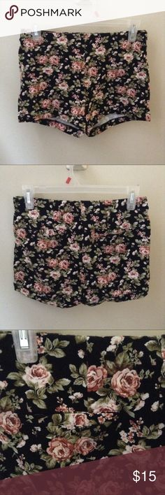 Floral Shorts Cloth material not denim. Has fake back pockets. About 14 inches at waist and 10 inches in length. Forever 21 Shorts