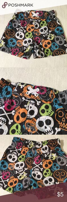 Circo Toddler Swim Trucks Size 9 Month EUC Circo Toddler Swim Trucks  Size 9 Month  100% Polyester  Love these swim trunks with the colorful skull print! They have a functional drawstring waist and mesh netting in the crotch. Shorts are in amazing condition with very little to no show of wear.   Thank you for sharing and please feel free to reach out with any questions or concerns! Circo Swim Swim Trunks
