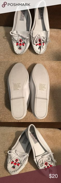 NWOT Leather Moccasins with Beaded Design, Size 9 Never worn! Beautiful white moccasins with fringe and beaded design on the toe. Leather upper and thick plastic sole. Real Comfort Shoes Moccasins