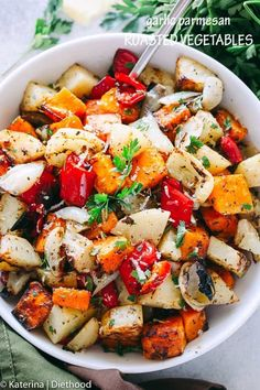 Garlic Parmesan Roasted Vegetables Garlic Parmesan Roasted Vegetables - Butternut squash potatoes peppers and onions tossed in the best garlic parmesan dressing and roasted to perfection!